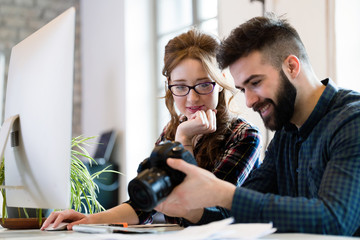 Two young designers working in modern office