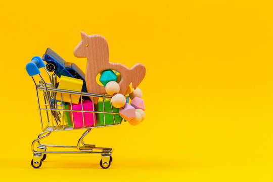 Shopping cart or supermarket trolley full of colorful numbers on yellow background