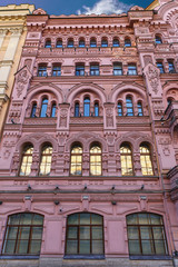 Front view of a stone ornamental building in the historic center of the city of St. Petersburg, Russia