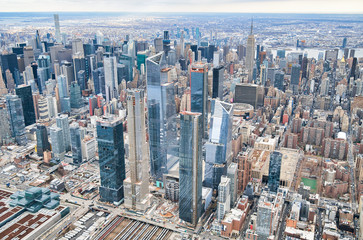 Wall Mural - New York City from helicopter point of view. Midtown Manhattan and Hudson Yards on a cloudy day