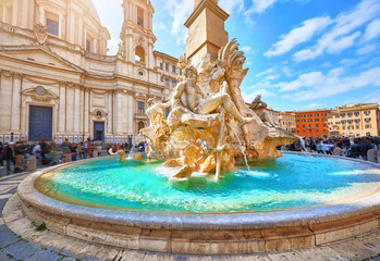 Rome, Italy. Fountain of the Four Rivers on Piazza Navona. Ancient fountain, statues, obelisk design of Bernini. Famous landmark touristic location near Sant Agnese in Agone church. Sunny summery day. Fototapete