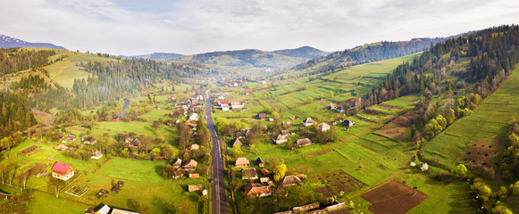 Road in mountain village. Aerial Panorama of Carpathian valley. Fototapete