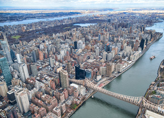 Wall Mural - New York City from helicopter point of view. Queensboro Bridge with Manhattan skyscrapers on a cloudy day