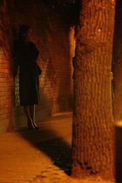 PROSTITUTE LURKS IN THE DARK WAITING FOR CUSTOMERS IN SHANGHAI.