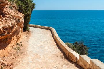 Walkway along the rocks coast and sea