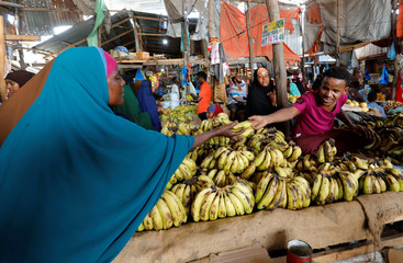 A muslim woman buys fruits during the month of Ramadan at the Hamarweyne market in Mogadishu
