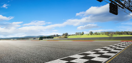 Wide angle view empty asphalt international race track with start and finish line , morning scene . Wall mural