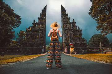 Traveller woman posing in front of a temple in Asia