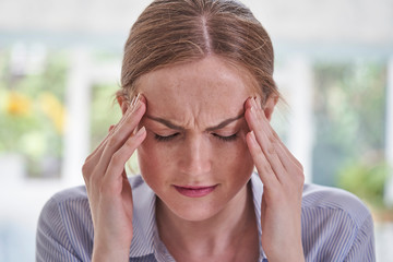 Close Up Shot Of Young Woman Suffering With Headache