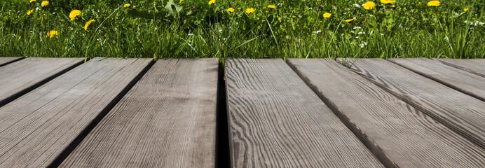 Empty wooden walkway in the green garden. Mock up space for garden tools.
