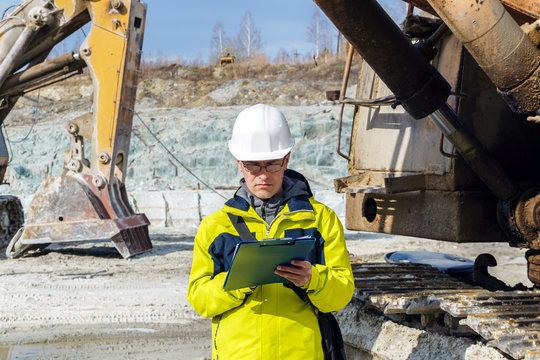 man geologist or mining engineer at work