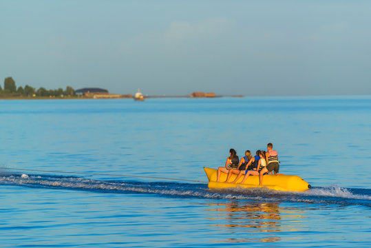 Water attraction banana. Extreme form of recreation. Rest in Kyrgyzstan. Trip to Issyk-Kul lake.