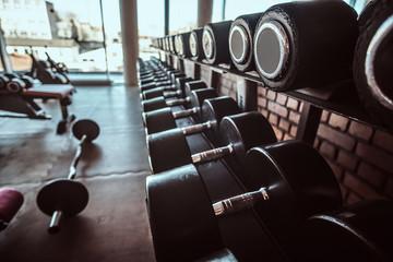 Keuken foto achterwand Fitness Photo of sport equipment in trendy sunny gym.