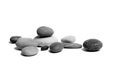 Obraz Sea pebbles. Heap of scattered and stacked smooth gray and black stones isolated on white background - fototapety do salonu