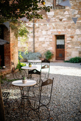 old tables in courtyard of tuscan villa