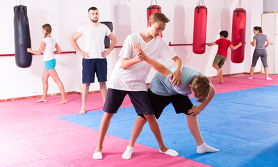 Kids practicing in pair self-protection