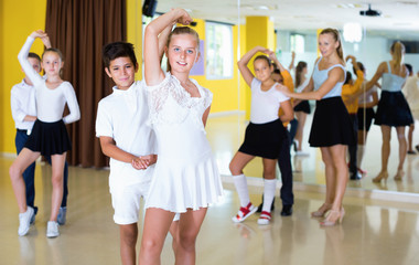 Little boys and girls having dancing class in classroom