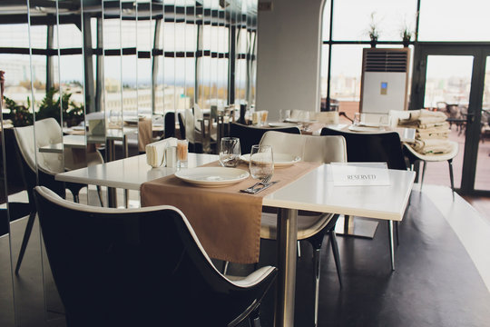 Cozy wooden interior of restaurant, copy space. Comfortable modern dining place, contemporary design background.