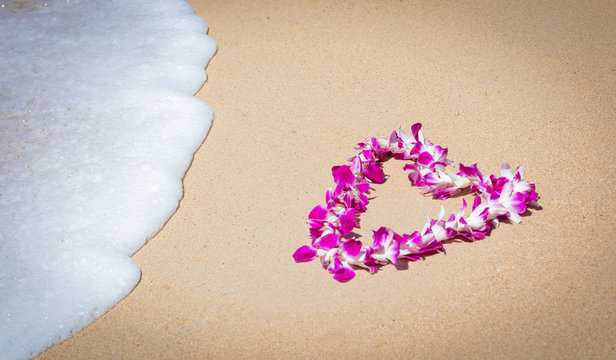 Orchid Lei on a Maui beach with soft surf