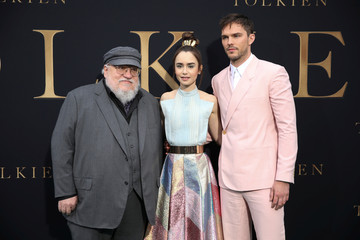 "Novelist George R. R. Martin poses with actors Lily Collins and Nicholas Hoult at the premiere of the film ""Tolkien"" in Los Angeles"