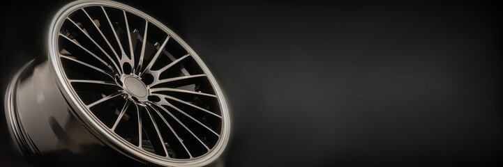 new Luxury Black alloy Wheel, sporty with thin spokes, copy cpace on black background Fototapete