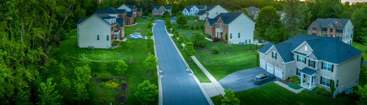 Aerial panorama of modern upper middle class single family homes neighborhood street American real estate in a new construction in Maryland USA