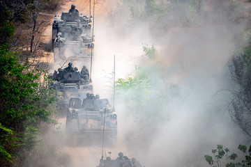 Backside of  Soldier army operation, Grunge style image of modern armored tanks in battle