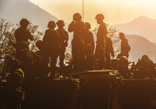 Backside of  Soldier army operation, Military equipment, army helmet, warpaint, smoked dirty face.