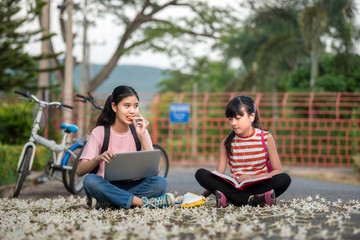 Little two girls prepare back to school after the school long holidays  with school bag, primary education level, education concept.
