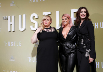 "Cast members Hathaway and Wilson pose with singer Trainor at the premiere for the movie ""The Hustle"" in Los Angeles"