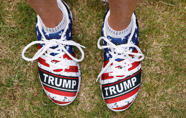 """A supporter sports """"Trump"""" monogrammed shoes while waiting for the arrival of U.S. President Donald Trump during a campaign rally in Panama City, Florida"""