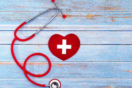 World Red Cross day. Red heart with Stethoscope on wooden table background