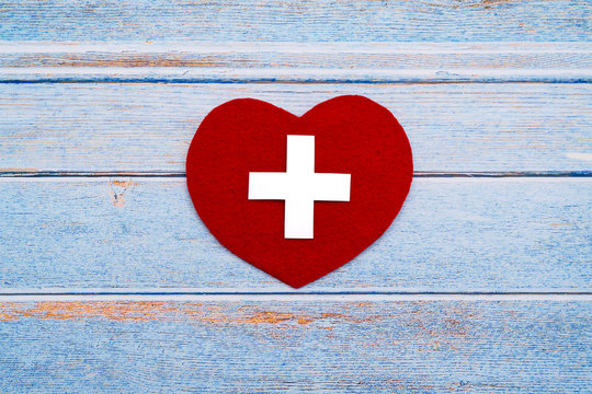 World Red Cross day. Red heart on wooden table background