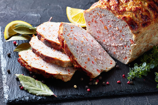 sliced chicken meatloaf on a slate tray