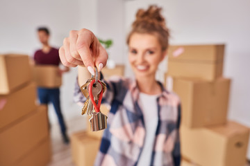 Woman's hand showing keys from new apartment