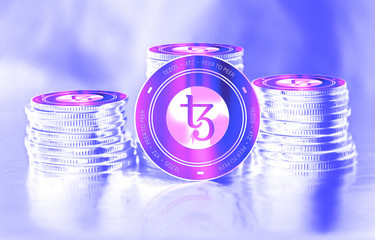 Tezos (XTZ) digital crypto currency. Stack of coins. Cyber money.