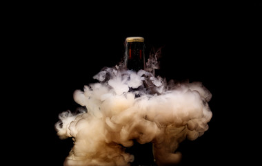 Liquid water explosions surrounding beer bottle. Underwater liquid photography