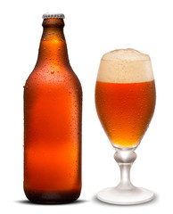 Glass of beer and Brown bottle with drops isolated on a white background