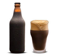 Glass of porter beer and Brown bottle with drops isolated on a white background