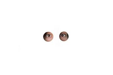 Eyes peering through holes in white wall