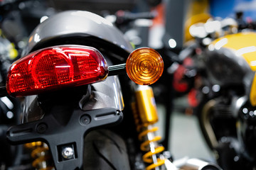 Close up of the rear of a brand new clasic motorcycle, soft focus, abstract background - Image