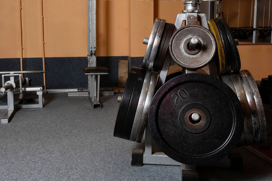 Barbell plates holder rack in the gym - Image