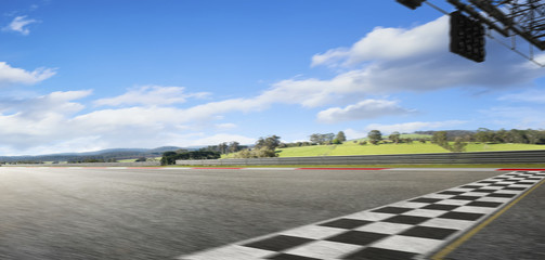 Wall Mural - Motion blurred racetrack with start and finish line , morning scene .
