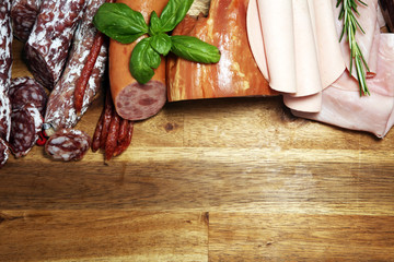 Tuinposter Kruiderij cold meat assortment with delicious salami and fresh herbs . Variety of meat products including coppa and sausages
