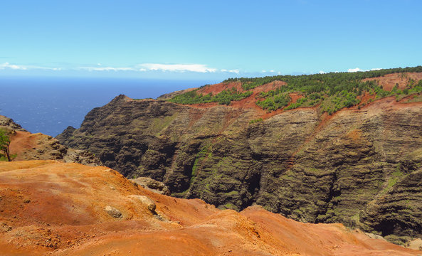 Red rocks, sand and cliffs at Waimea Canyon, aka the Grand Canyon of the Pacific, Kauai, Hawaii, USA