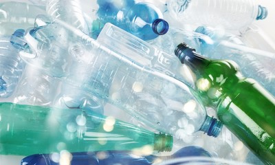 Plastic bottles of water isolated on background