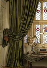 Silk curtain on window with still life