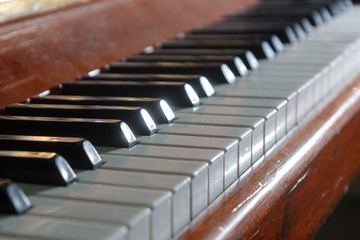 piano keys on an old wooden piano