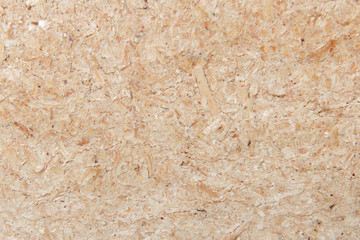 Background from a freshly cut brown sawdust