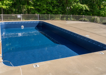In ground swimming poolwith new vinyl liner being refilled with water ready for use